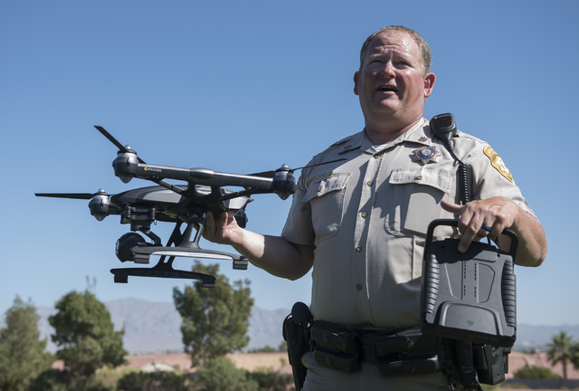 Las Vegas police officer Dave Martel talks about the safe operation of unmanned aircraft systems, commonly known as drones, during a news conference at Police Memorial Park in Las Vegas on Tuesday ...