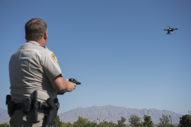 Las Vegas police officer Dave Martel flies a Typhoon Q500 drone during a demonstration about the safe operation of unmanned aircraft systems during a news conference at Police Memorial Park in Las ...