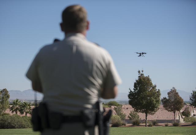 Las Vegas police officer Dave Martel operates a Typhoon Q500 drone during a demonstration about the safe operation of unmanned aircraft systems during a news conference at Police Memorial Park in  ...