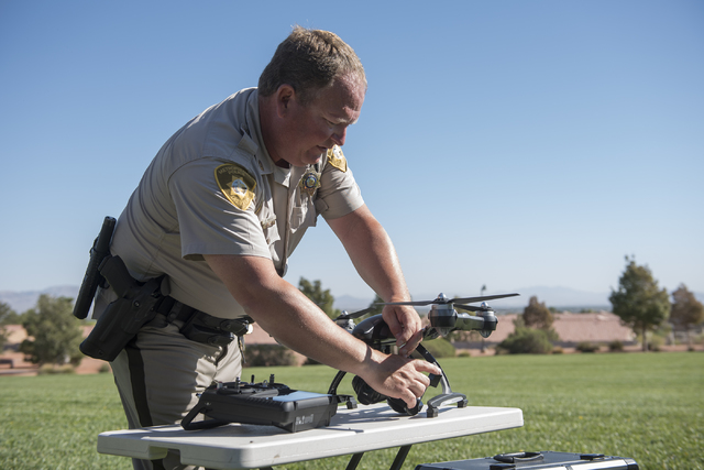Las Vegas police officer Dave Martel prepares a Typhoon Q500 drone during a demonstration about the safe operation of unmanned aircraft systems during a news conference at Police Memorial Park in  ...