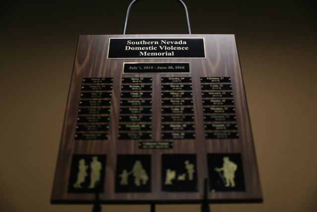 A plaque with names of people who died as a result of intimate partner violence sits on display during a remembrance ceremony at the Metropolitan Police Department headquarters in Las Vegas on Thu ...