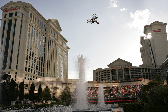 Mike Metzger does a backflip over the fountains at Caesars Palace in Las Vegas Thursday, May 4, 2006. The jump was the longest backflip on a motorcycle. John Locher/Las Vegas Review-Journal