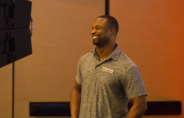 Bart Scott, a former NFL linebacker and current NFL Today analyst, smiles ahead of giving a presentation at the UFC Veteran Athlete Summit in Las Vegas on Oct. 28, 2016. (Heidi Fang/Las Vegas Revi ...