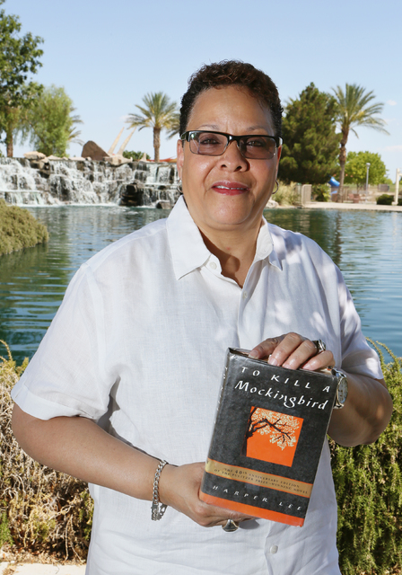 """Nevada State Sen. Pat Spearman holds a copy of Harper Lee's """"To Kill a Mockingbird"""" at Aliante Nature Discovery Park Thursday, July 2, 2015, in North Las Vegas. Spearman often qu ..."""