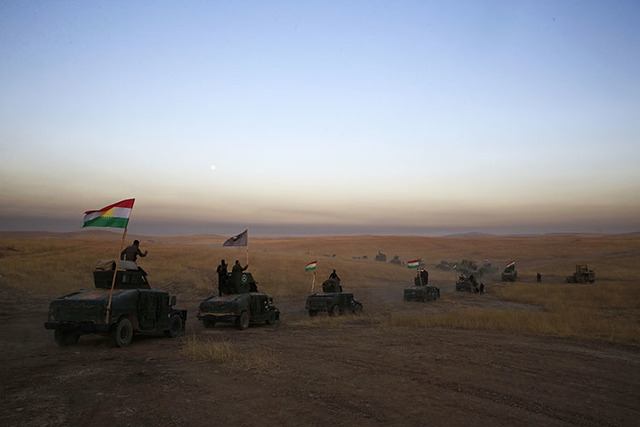 A Peshmerga convoy drives toward a frontline east of Mosul, Iraq, Monday, Oct. 17, 2016.  The Iraqi military and the country's Kurdish forces say they launched operations to the south and east of  ...