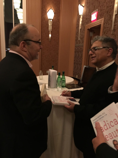 Smith Center President Myron Martin meets wellness icon Deepak Chopra at Smith Center on Friday night. (John Katsilometes photo)