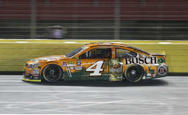 Kevin Harvick drives during the final round of qualifying for Saturday's NASCAR Sprint Cup series auto race at Charlotte Motor Speedway in Charlotte, N.C., Thursday, Oct. 6, 2016. Harvick won the  ...