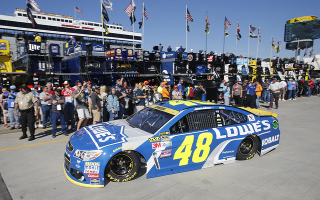 Sprint Cup Series driver Jimmie Johnson (48) leaves the garage during practice for Sunday's Sprint Cup auto race at Martinsville Speedway in Martinsville, Va., Saturday, Oct. 29, 2016. (AP Photo/S ...