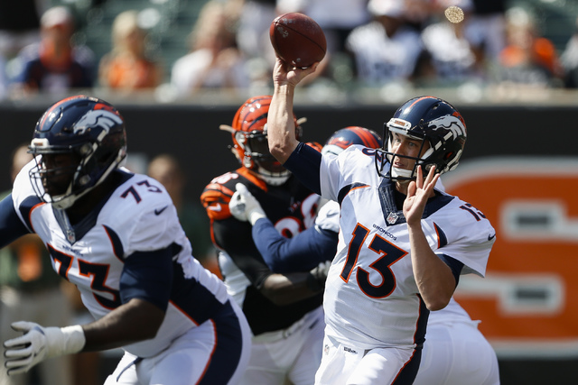 FILE - In this Sept. 25, 2016, file photo, Denver Broncos quarterback Trevor Siemian (13) throws during the first half of an NFL football game against the Cincinnati Bengals in Cincinnati. Siemian ...