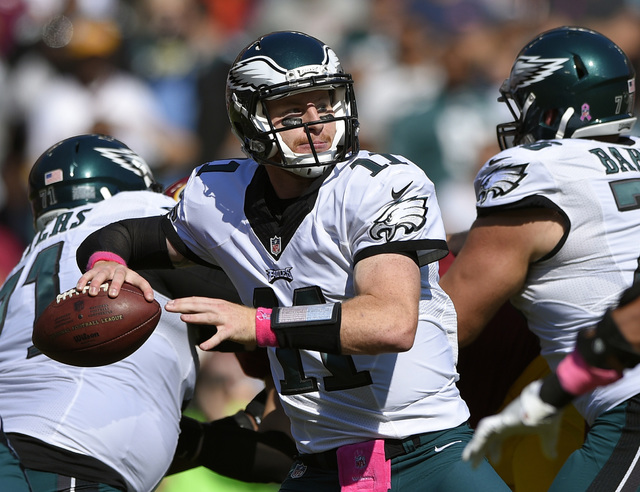 FILE - In this Sunday, Oct. 16, 2016, file photo, Philadelphia Eagles quarterback Carson Wentz throws to a receiver in the first half of an NFL football game against the Washington Redskins in Lan ...