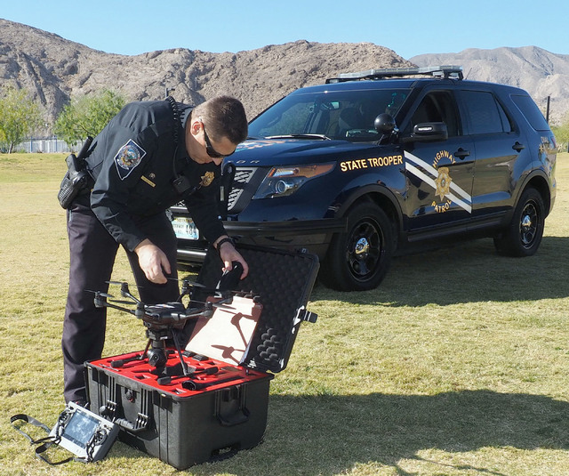 Nevada Highway Patrol Trooper Daniel Marek unpacks a Yuneec Typhoon H unmanned aerial vehicle during a news conference at Lone Mountain Regional Park in Las Vegas, Friday, Oct. 21, 2016. Jerry Hen ...