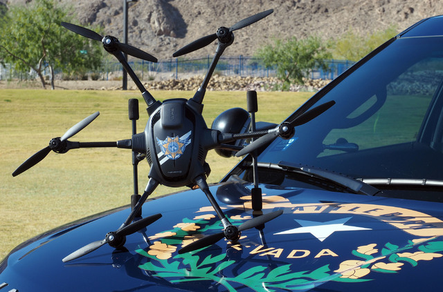 A Yuneec Typhoon H unmanned aerial vehicle is shown during a news conference by the Nevada Highway Patrol at Lone Mountain Regional Park in Las Vegas, Friday, Oct. 21, 2016.The UAV is used by the  ...