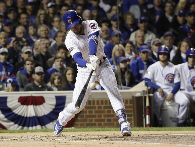 Chicago Cubs third baseman Kris Bryant (17) hits an RBI single during the first inning of Game 6 of the National League baseball championship series against the Los Angeles Dodgers, Saturday, Oct. ...