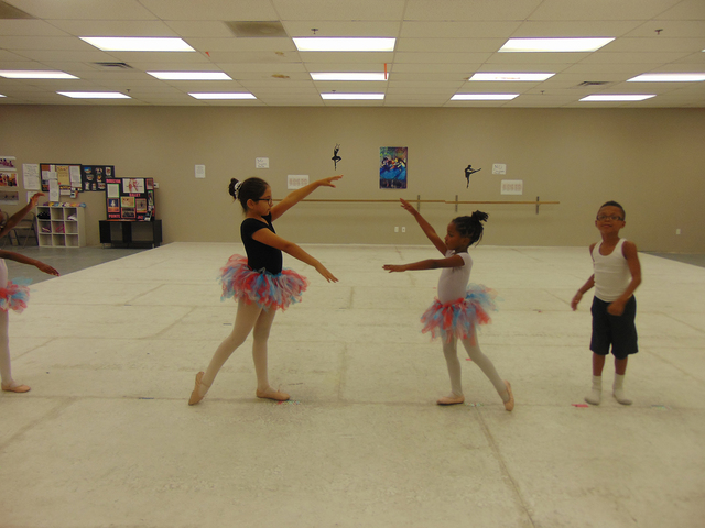 """North Las Vegas Ballet Theater junior ballet ensemble members, Renata Tripp, 9, from left to right, Aveah Boykins, 6 and Demtri Johnson-Quin, 6 rehearse for the """"Dancing with the North Las Vegas ..."""