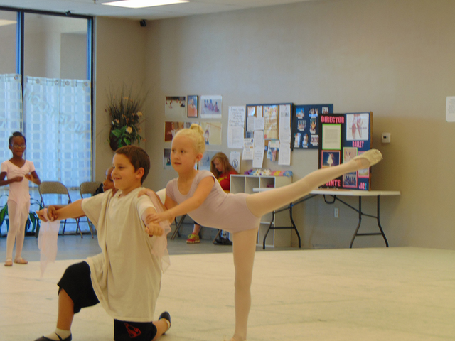 """North Las Vegas Ballet Theater junior ballet ensemble members Lucas Johnson, 8, left, and Olivia Holyoak, 8, rehearse for the """"Dancing with the North Las Vegas Stars Gala"""" at the school at 205 ..."""