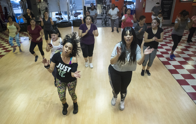 Zumba teacher Ana Bastian, left and Rosie Mercado instruct a Zumba class at Dance 4 Energy on Sept. 21, 2016. (Loren Townsley/View)