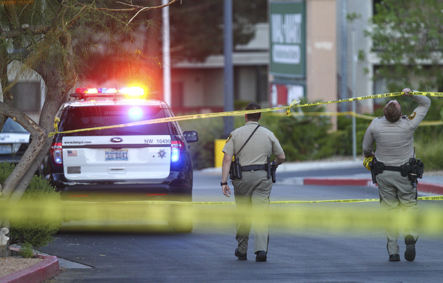 Las Vegas police investigate a homicide outside of a Walgreens at Lake Mead and Jones Boulevards in Las Vegas on June 29, 2016. (Chase Stevens/Las Vegas Review-Journal) Follow @csstevensphoto