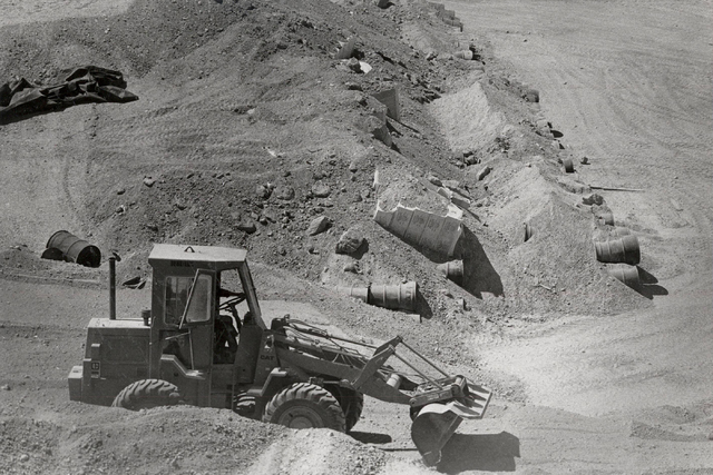 A front-loader scrapes the surface of the low-level radioactive waste landfill, 11 miles south of Beatty, in this undated photo. (Las Vegas Review-Journal file)