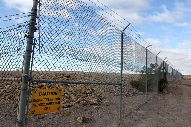 Just beyond the fence is the site of the October 18, 2015 eruption and fire at the closed, state-owned low-level radioactive waste landfill, 11 miles south of Beatty as it looks on October 17, 201 ...