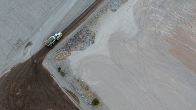 An aerial view shows Trench 14, right, at Nevada's low-level radioactive waste landfill on Oct. 17, 2016, nearly a year after explosions created a crater when rainwater reacted with metallic sodiu ...