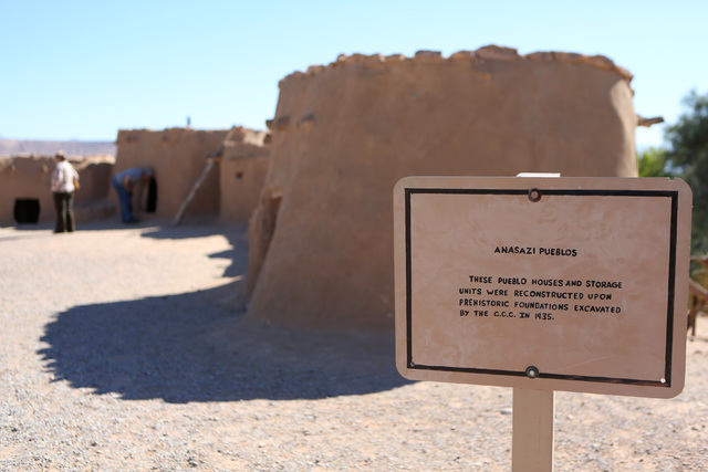 People tour pueblo dwelling replicas outside the Lost City Museum Thursday, Oct. 17 2013, in Overton, Nev. The museum, located at 721 S. Moapa Valley Blvd., contains artifacts found in Southern Ne ...