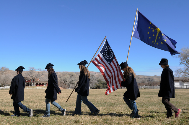 Participants in an educational Civil War re-enactment march to the battlefield carrying flags at Spring Mountain Ranch State Park. (Erik Verduzco/Las Vegas Review-Journal)