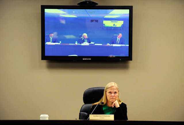 Nevada Public Utilities Commission Chairwoman Alaina Burtenshaw appears below a television monitor during the PUC video conference in Las Vegas Monday, Dec. 16, 2013. Burtenshaw was recently appoi ...
