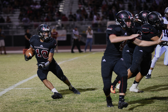 Desert Oasis Cordell Wooten (10) runs the ball against Silverado's defense during their football game played at Desert Oasis football field in Las Vegas on Friday, Sept. 9, 2016. (Martin S. Fuente ...