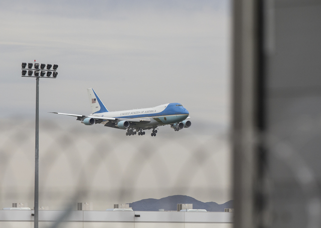 Air Force One lands on Sunday, Oct. 23, 2016, at McCarran International Airport, in Las Vegas. President Barack Obama was in Las Vegas campaigning for Democratic presidential nominee Hillary Clint ...