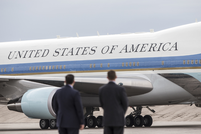 Air Force One taxis after landing on Sunday, Oct. 23, 2016, at McCarran International Airport, in Las Vegas. U.S. President Barack Obama was in Las Vegas campaigning for Democratic presidential no ...