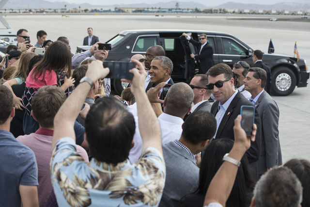U.S. President Barack Obama greets supporters on Sunday, Oct. 23, 2016, at McCarran International Airport, in Las Vegas. President Obama was in Las Vegas campaigning for Democratic presidential no ...