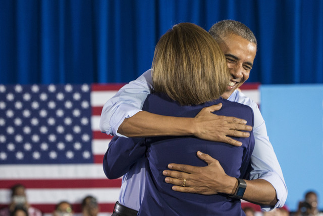 President Barack Obama hugs U.S. Senate candidate Catherine Cortez Masto at a rally organized by the Nevada State Democratic Party at Cheyenne High School on Sunday, Oct. 23, 2016, in North Las Ve ...