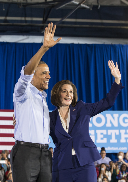 President Barack Obama and U.S. Senate candidate Catherine Cortez Masto wave to the crowd at a rally organized by the Nevada State Democratic Party at Cheyenne High School on Sunday, Oct. 23, 2016 ...