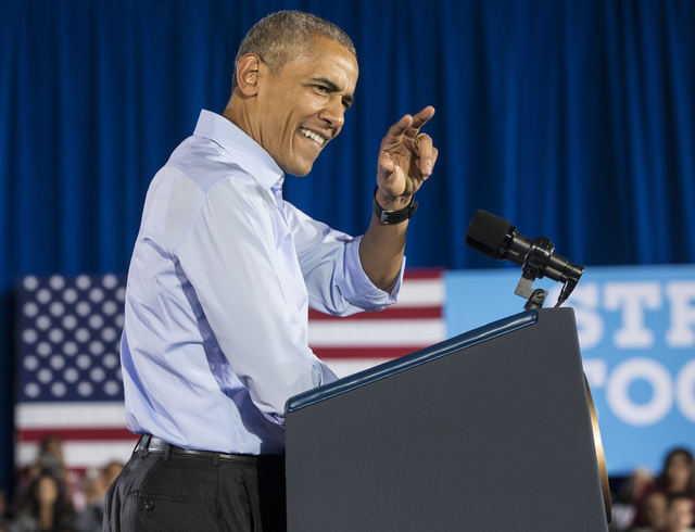 President Barack Obama waves at the crowd at a rally organized by the Nevada State Democratic Party at Cheyenne High School on Sunday, Oct. 23, 2016, in North Las Vegas. President Obama was campai ...