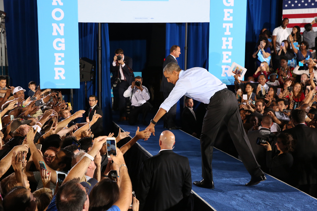 President Barack Obama shakes hands with supporters at a rally organized by the Nevada State Democratic Party at Cheyenne High School on Sunday, Oct. 23, 2016, in North Las Vegas. President Obama  ...