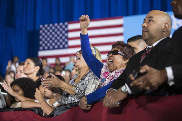 Supporters of President Barack Obama cheer during a rally organized by the Nevada State Democratic Party at Cheyenne High School on Sunday, Oct. 23, 2016, in North Las Vegas. President Obama was c ...
