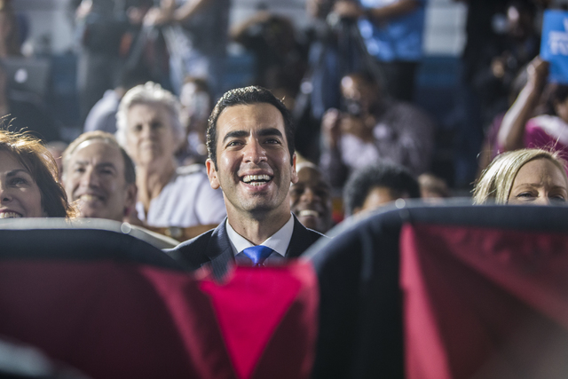 State Senator Ruben Kihuen, D-Nevada, listens to President Barack Obama at a rally organized by the Nevada State Democratic Party at Cheyenne High School on Sunday, Oct. 23, 2016, in North Las Veg ...