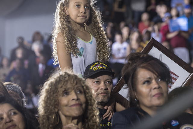 Supporters of President Barack Obama listen to the President speak during a rally organized by the Nevada State Democratic Party at Cheyenne High School on Sunday, Oct. 23, 2016, in North Las Vega ...