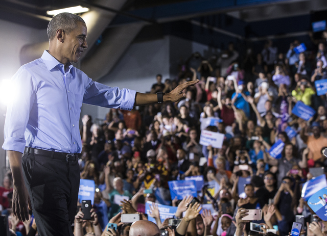 President Barack Obama waves to supporters at a rally organized by the Nevada State Democratic Party at Cheyenne High School on Sunday, Oct. 23, 2016, in North Las Vegas. President Obama was campa ...