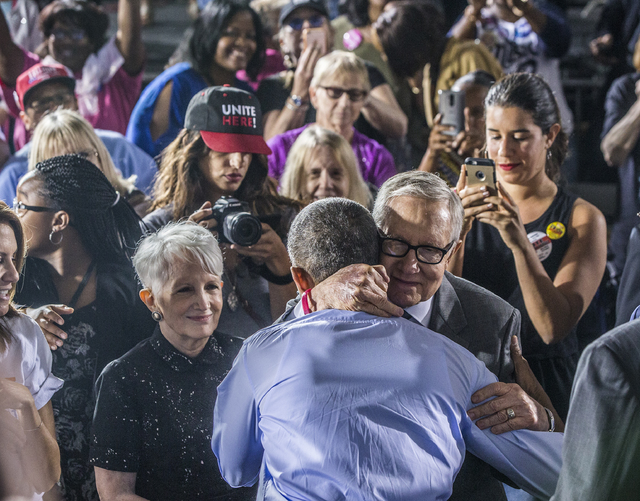 Senate Minority Leader Harry Reid, D-Nevada, hugs President Barack Obama during a rally organized by the Nevada State Democratic Party at Cheyenne High School on Sunday, Oct. 23, 2016, in North La ...