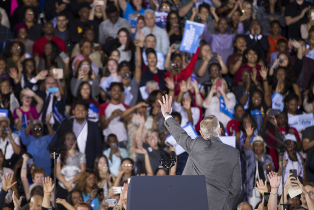 U.S. Sen. Harry Reid, D-Nev., waves at supporters during a campaign rally for Democratic presidential nominee Hillary Clinton at Cheyenne High School on Sunday, Oct. 23, 2016, in North Las Vegas.  ...