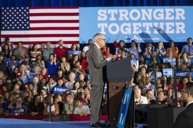 U.S. Sen. Harry Reid, D-Nev., pauses during speech in a campaign rally for Democratic presidential nominee Hillary Clinton at Cheyenne High School on Sunday, Oct. 23, 2016, in North Las Vegas. Eri ...
