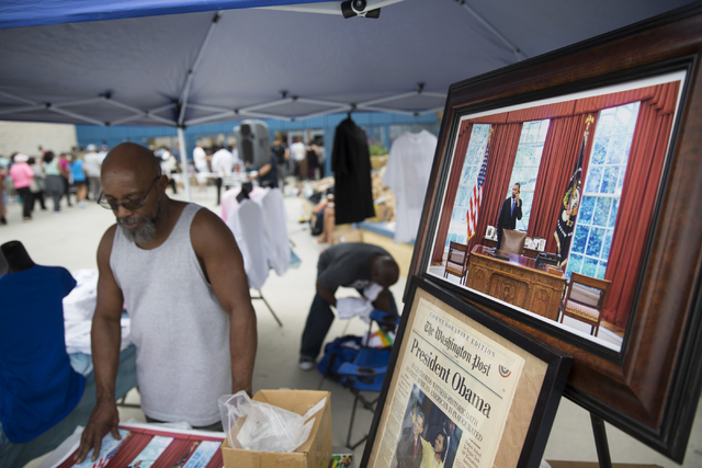 A vendor sells political merchandise outside of Cheyenne High School before a campaign rally for Democratic presidential nominee Hillary Clinton with President Barack Obama on Sunday, Oct. 23, 201 ...