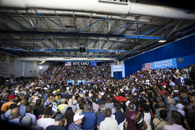 People attend a campaign rally for Democratic presidential nominee Hillary Clinton with President Barack Obama at Cheyenne High School on Sunday, Oct. 23, 2016, in North Las Vegas. Erik Verduzco/L ...