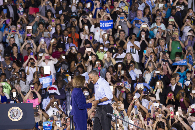 Democratic U.S. Senate candidate Catherine Cortez greets President Barack Obama on stage during a campaign rally for Democratic presidential nominee Hillary Clinton at Cheyenne High School on Sund ...
