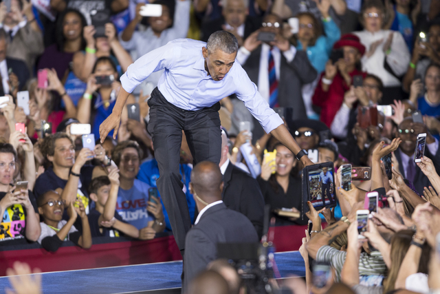 President Barack Obama takes the stage for a campaign rally speech for Democratic presidential nominee Hillary Clinton at Cheyenne High School on Sunday, Oct. 23, 2016, in North Las Vegas. Erik Ve ...