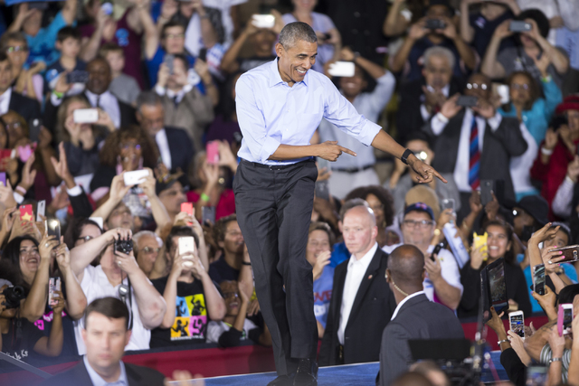 President Barack Obama gestures at supporters as he takes the stage for a campaign rally speech for Democratic presidential nominee Hillary Clinton at Cheyenne High School on Sunday, Oct. 23, 2016 ...