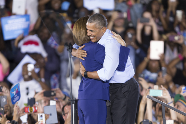 Democratic U.S. Senate candidate Catherine Cortez hugs President Barack Obama on stage during a campaign rally for Democratic presidential nominee Hillary Clinton at Cheyenne High School on Sunday ...