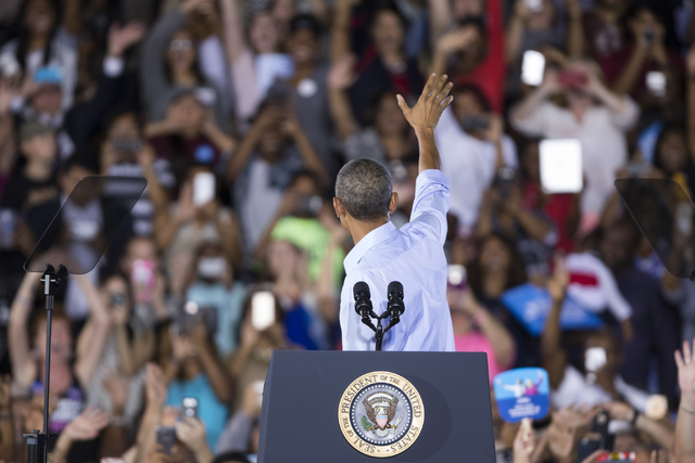 President Barack Obama waves at supporters before his speech during a campaign rally for Democratic presidential nominee Hillary Clinton at Cheyenne High School on Sunday, Oct. 23, 2016, in North  ...