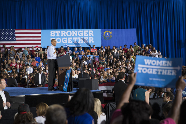 President Barack Obama pauses in his speech during a campaign rally for Democratic presidential nominee Hillary Clinton at Cheyenne High School on Sunday, Oct. 23, 2016, in North Las Vegas. Erik V ...